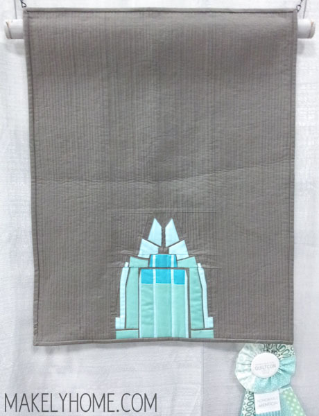 Mini modern art quilt featuring this Frost Bank building from the Austin skyline - by Claire Jain | MakelyHome.com
