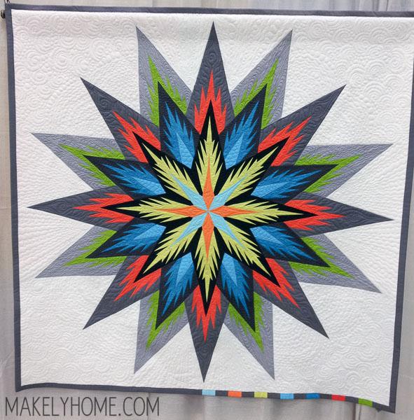 Starburst themed modern art quilt - blue, red, green, orange - Stella by Susan Strong | MakelyHome.com