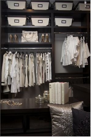Closet with dark shelving and gray walls - via Robeson Design | Makely School for Girls