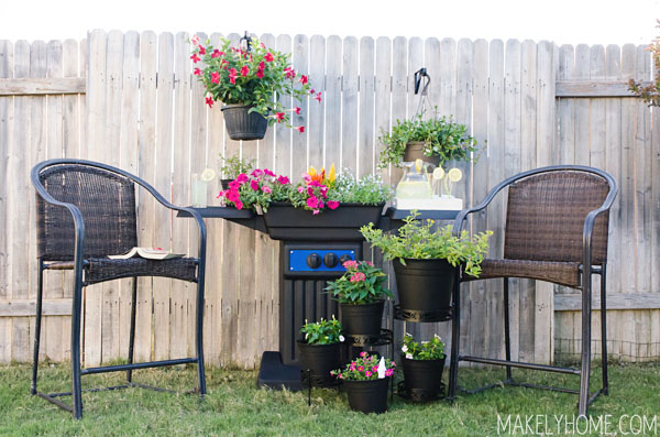 Lovely sitting area with an awesome upcycled BBQ grill turned planter. via MakelyHome.com