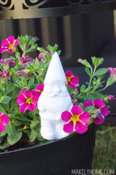 Little gnome in a cute flower planter made from an upcycled BBQ grill via MakelyHome.com