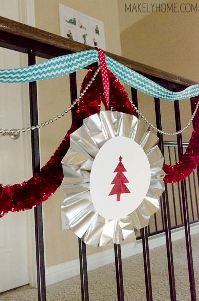 how to make a foil paper pinwheel garland via MakelyHome.com