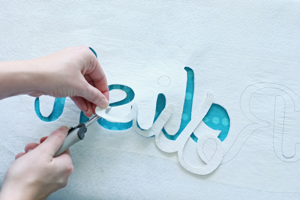 Cutting out lettering for a typography pillow | Teal & Lime for makelyhome.com