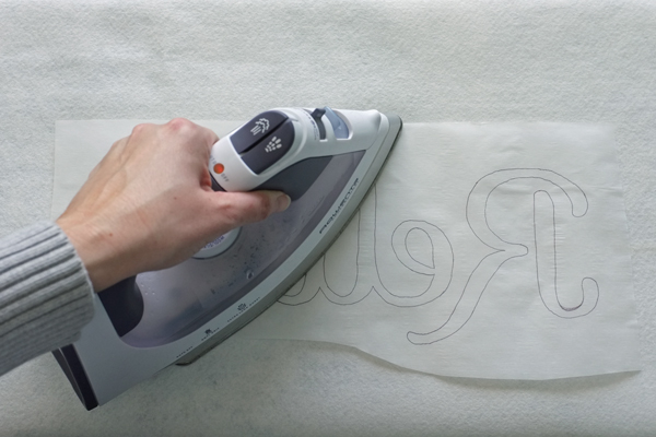 How to use iron on fusible web to make a typography pillow | by Teal & Lime for MakelyHome.com