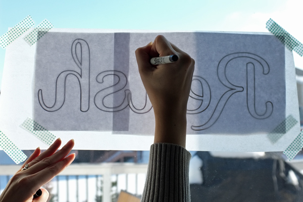 Use a window as a light box to trace lettering | makelyhome.com