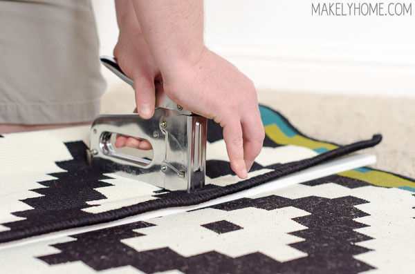 how to hang a rug on a wall via MakelyHome.com